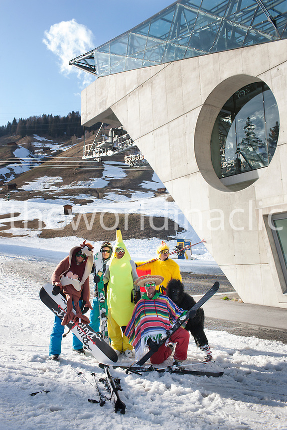 AUSTRIA, St. Anton am Arlberg, British Skiers in Costumes infront of the main Gondola building