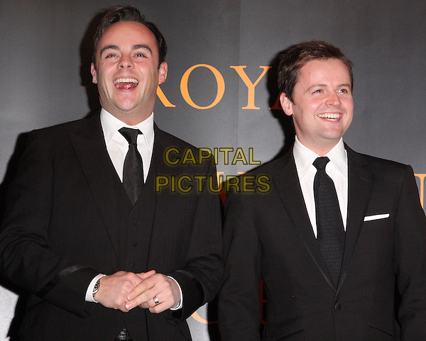 ANTHONY McPARTLIN & DECLAN DONNELLY.Royal Television Society Programme Awards held at the Grosvenor House Hotel, Park Lane, London, England..March 16th, 2010.RTS half length ant dec black suit jacket mouth open smiling laughing .CAP/ROS.©Steve Ross/Capital Pictures.