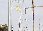 A helicopter pulls cable onto the new transmission lines of the Oceanview Transmission Project for JCP&L on April 28, 2016 in Neptune, New Jersey.