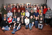 Tuesday February 16, 2010.  Volunteer Iditarod Airforce pilots and pilot support volunteers  pose for a photo prior to their final meeting before the race flying begins.  Millenium hotel race headquarters.