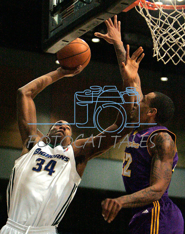 Reno Bighorns Hassan Whiteside shoots over Los Angeles D-FendersMalcolm Thomas during the men's basketball game in Reno, Nev., on Friday, Jan. 6, 2012. The D-Fenders won 109-78..Photo by Cathleen Allison