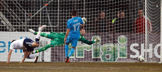 Andraz Kirim heads past Allan McGregor to open the scoring for Slovenia
