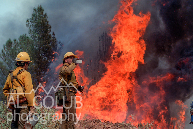 August 13, 1990 Yosemite National Park  --  A-Rock (Arch Rock) Fire  -- Firefighter Pat Laeng takes drink during backburning operations on Trumbull Peak.  The Arch Rock Fire burned over 16,000 acres of Yosemite National Park and the Stanislaus National Forest.  At the same time across the Merced River, the Steamboat Fire burned over 5,000 acres of both Yosemite National Park and the Sierra National Forest.