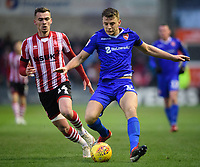 Morecambe's Josef Yarney under pressure from Lincoln City's Harry Toffolo<br /> <br /> Photographer Chris Vaughan/CameraSport<br /> <br /> The EFL Sky Bet League Two - Saturday 15th December 2018 - Lincoln City v Morecambe - Sincil Bank - Lincoln<br /> <br /> World Copyright © 2018 CameraSport. All rights reserved. 43 Linden Ave. Countesthorpe. Leicester. England. LE8 5PG - Tel: +44 (0) 116 277 4147 - admin@camerasport.com - www.camerasport.com