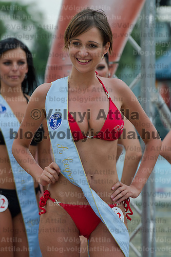 Adrienn Lukacs receives the ribbon for the most beautiful decolletage during the Miss Bikini Hungary beauty contest held in Budapest, Hungary on August 06, 2011. ATTILA VOLGYI