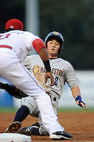 Outfielder Danny Oh (8) of the Charleston RiverDogs is tagged out sliding into third base in a game against the Greenville Drive on Wednesday, August 28, 2013, at Fluor Field at the West End in Greenville, South Carolina. Making the tag is Greenville's Mario Martinez (10). Greenville won, 2-1. (Tom Priddy/Four Seam Images)
