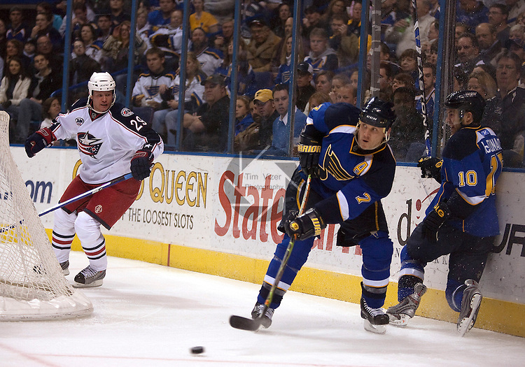 April 10 2009      Blue Jackets player Jason Williams (29, far left) watches as Blues player Keith Tkachuk (7, center) passes from behind the Blue Jackets goal to a teammate.  At far right is Blues player Andy McDonald (10).  The St. Louis Blues hosted the Columbus Blue Jackets in the final regular season home game for the Blues at the Scottrade Center in downtown St. LOuis, MO.  ..            *******EDITORIAL USE ONLY*******