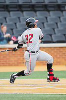 Kevin Martir (32) of the Maryland Terrapins follows through on his swing against the Wake Forest Demon Deacons at Wake Forest Baseball Park on April 4, 2014 in Winston-Salem, North Carolina.  The Demon Deacons defeated the Terrapins 6-4.  (Brian Westerholt/Four Seam Images)