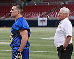 "Kurt Warner and Mike Martz watch the game. Martz coached the ""Blue"" team, and Warner was QB for them."