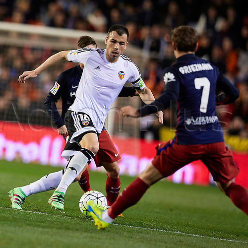 06.03.2016. Mestalla Stadium, Valencia, Spain. La Liga match between Valencia versus Atletico Madrid. (C) Midfielder Javi Fuego of Valencia CF is challenged by Forward Griezmann of Atletico Madrid