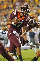 Landover, MD - September 3, 2017: Virginia Tech Hokies quarterback Josh Jackson (17) runs the ball during game between Virginia Tech and WVA at  FedEx Field in Landover, MD.  (Photo by Elliott Brown/Media Images International)