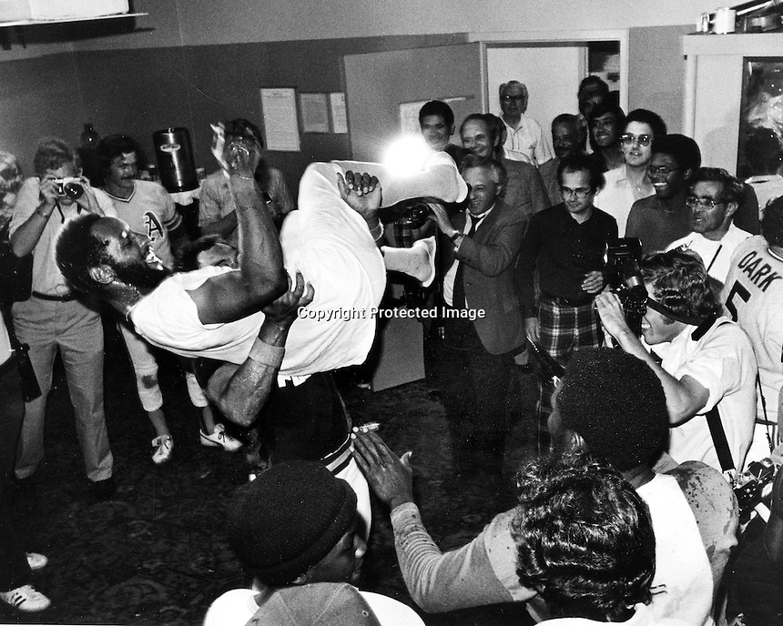 Oakland A's celebrate in the locker room after cinching the 1974 American League championship.<br />