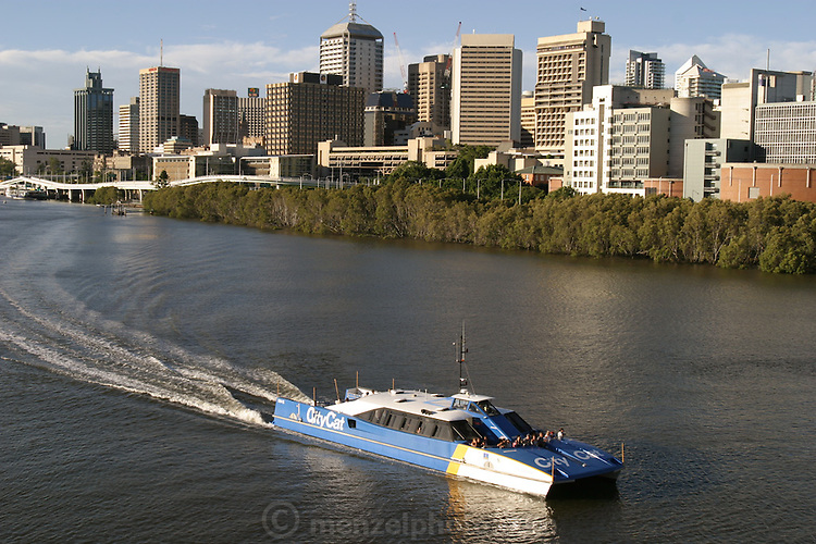 The City Cat tourist boat cruises by downtown Brisbane, Australia. (Supporting image from the project Hungry Planet: What the World Eats.)