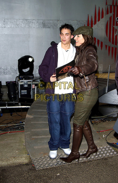 KENZIE & DAVINA McCALL.Celebrity Big Brother 3 Grand Final, Elstree Studios, Hertfordshire..January 23rd, 2005.full length, white trainers, jeans, denim, brown leather jacket, green trousers tucked into brown boots.www.capitalpictures.com.sales@capitalpictures.com.©Capital Pictures