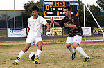 Palos Verdes, CA 01/22/13 - Tony Bumatay (Peninsula #5) and Michael Johnson  (West Torrance #8) in action during the West vs Peninsula boys varsity soccer game at Peninsula High School.