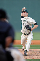 Closer Jake Lowery (12) of the Michigan State Spartans delivers a pitch in a game against the Harvard Crimson on Saturday, March 15, 2014, at Fluor Field at the West End in Greenville, South Carolina. Michigan State won, 4-0. (Tom Priddy/Four Seam Images)