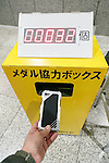 A man donates his old smart phone to make medals for the 2020 Tokyo Olympic and Paralympic Games at Tokyo Metropolitan Government Building on February 21, 2017, Tokyo, Japan. Tokyo Government has asked for people to donate their old electronic gadgets (including smart phones, mobile phones and tablets) with the aim of collecting and recycling eight tonnes of gold, silver and bronze to make the 5,000 medals needed for the 2020 Tokyo Olympic and Paralympic Games. The recycling campaign started on Thursday, February 16. (Photo by Rodrigo Reyes Marin/AFLO)