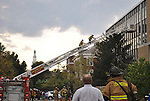 A lexington firefighter and UK official watch as two lexington firefighters climb up a ladder to the Chem-Phys building September 7.