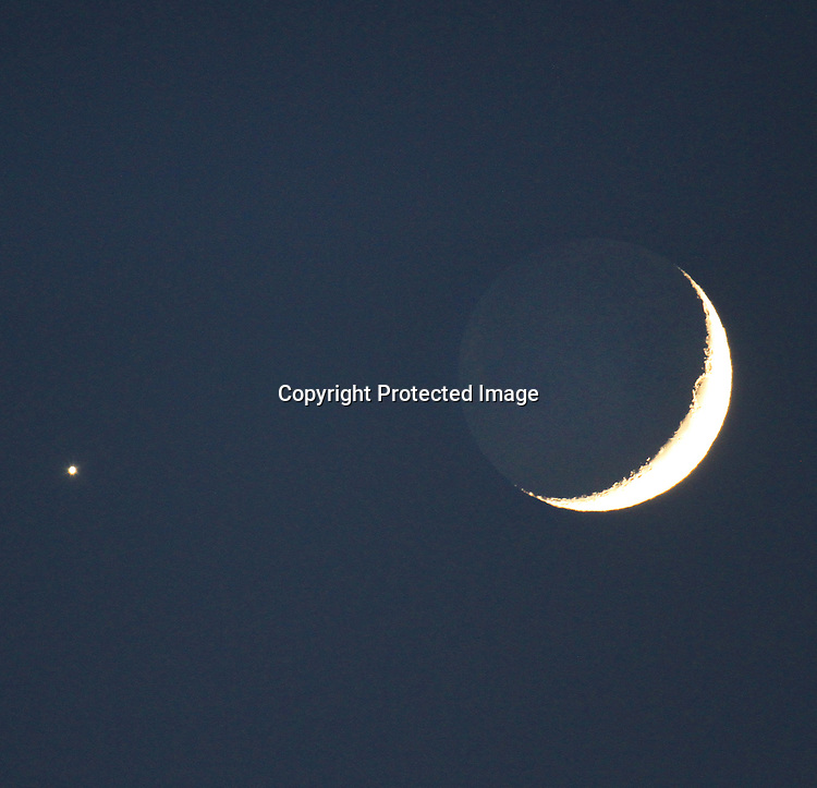 The crescent moon and brightest planet Venus will draw the eyes of the world Sunday evening. That's because the pair will be fairly high up in the west after sunset, easiely viewed by all who have a clear sky. When you see them, be sure to notice the soft glow of earthshine – twice-reflected sunlight – on the nighttime side of the moon.