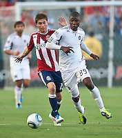 CARSON, CA – July 2, 2011: Chivas USA midfielder Jorge Flores (19) and Chicago Fire defender Yamith Cuesta (89) during the match between Chivas USA and Chicago Fire at the Home Depot Center in Carson, California. Final score Chivas USA 1, Chicago Fire 1.