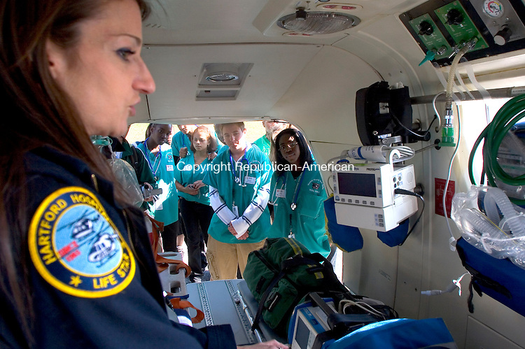 WATERBURY, CT - 03 OCTOBER 2008 100308JW02.jpg -- Life Star EMT Rebecca Lange shows off the cramped patient area aboard the Life Star helicopter to Wilby High school students Friday morning. Jonathan Wilcox Republican-American