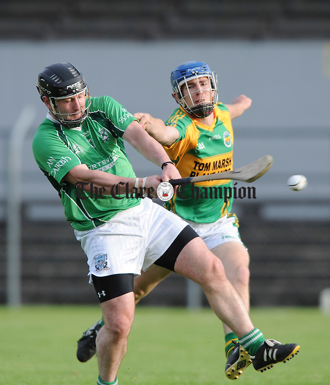 Brian Harte of Scariff in action with James Gunning of Broadford during their Senior Championship clash at Cusack Park. Photograph by John Kelly.