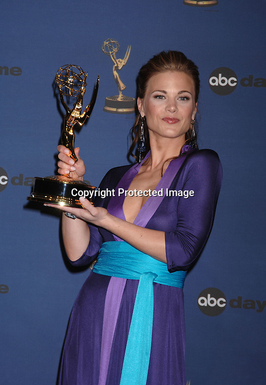 Gina Tognoni, winner for Best Supporting Actress..in the Press Room  at the 33rd Annual Daytime Emmy Awards on April 28, 2006 at The Kodak Theatre in Hollywood, Californina. ..Robin Platzer, Twin Images
