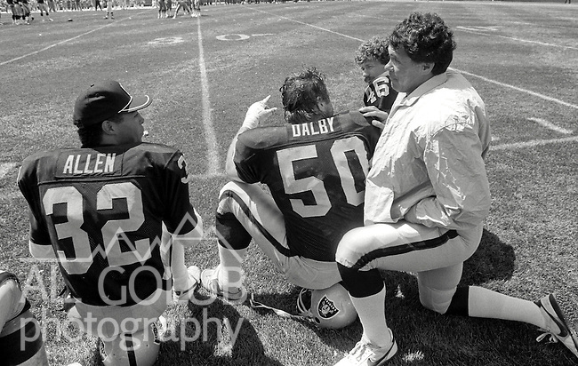 San Francisco 49ers vs. Los Angles Raiders at Candlestick Park Sunday, August 10, 1986..Preseason Game.Los Angles Raiders Running Back Marcus Allen (32), Center Dave Dalby (50), Tight End Todd Christensen (46) and Quarterback Jim Plunkett (16) kneel on sidelines..
