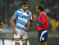 Referee Romain Poite talks to Argentina captain Juan Martin Fernandez Lobbe during the Rugby Championship international rugby test match between the All Blacks and Argentina at Westpac Stadium, New Zealand on Saturday, 8 September 2012. Photo: Dave Lintott / lintottphoto.co.nz