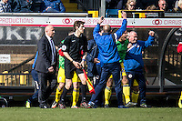 The full-time whistle goes and the Accrington Stanley bench with Manager John Coleman (left) celebrate their win during the Sky Bet League 2 match between Wycombe Wanderers and Accrington Stanley at Adams Park, High Wycombe, England on the 30th April 2016. Photo by Liam McAvoy / PRiME Media Images.