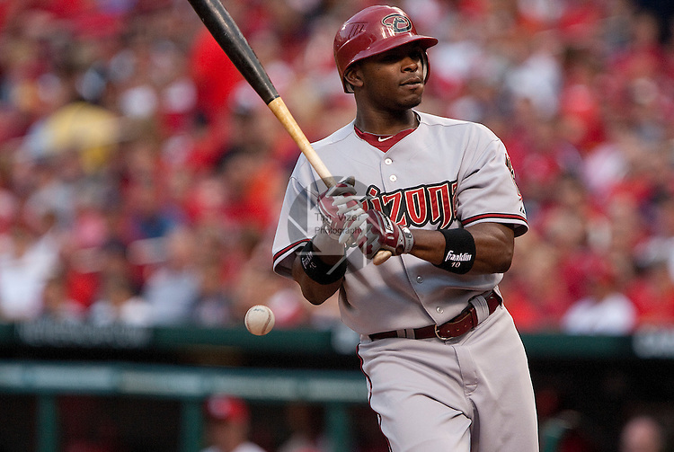 June 28, 2010    Arizona Diamondbacks right fielder Justin Upton (10) spins around as he tries to avoid getting hit by a pitch, but the ball thrown by Cardinals starting pitcher Chris Carpenter hit him in the back in the third inning.  The St. Louis Cardinals hosted the Arizona Diamondbacks in the first game of a three-game homestand at Busch Stadium in downtown St. Louis, MO on Monday June 28, 2010.