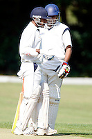 Harrow Town players B Thakkar (L) and M Arshad (R) feel the pressure during the Middlesex County Cricket League Division Two game between Hornsey and Harrow Town at Tivoli Road, Crouch End on Sat Sept 3, 2011