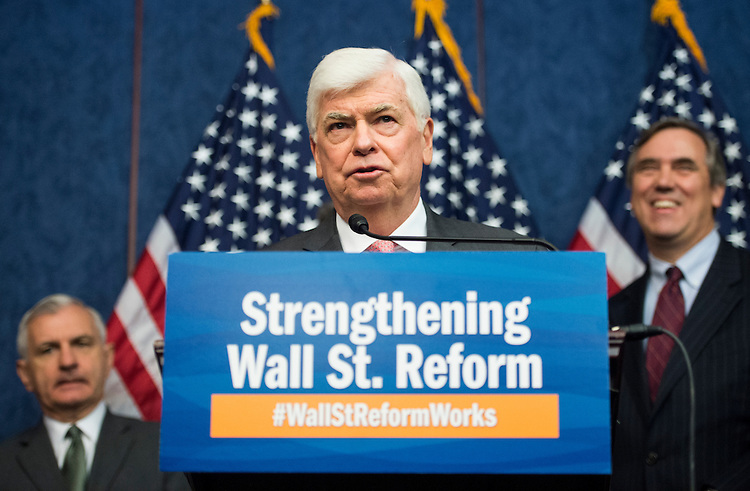 UNITED STATES - JULY 21: Former Sen. Chris Dodd, D-Conn., speaks during the Senate Democrats' news conference to highlight the fifth anniversary of Dodd-Frank financial reform legislation on Tuesday, July 21, 2015. Behind Dodd are Sens. Reed and Merkley. (Photo By Bill Clark/CQ Roll Call)