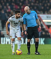 Wolverhampton Wanderers' Ruben Neves (left) prepares to take a free kick under the watchful eye of referee Roger East<br /> <br /> Photographer David Horton/CameraSport<br /> <br /> The Premier League - Bournemouth v Wolverhampton Wanderers - Saturday 23 February 2019 - Vitality Stadium - Bournemouth<br /> <br /> World Copyright © 2019 CameraSport. All rights reserved. 43 Linden Ave. Countesthorpe. Leicester. England. LE8 5PG - Tel: +44 (0) 116 277 4147 - admin@camerasport.com - www.camerasport.com