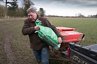 Shepherd carrying a bag of sheep feed<br /> &copy;Tim Scrivener Photographer 07850 303986<br /> ....Covering Agriculture In The UK....