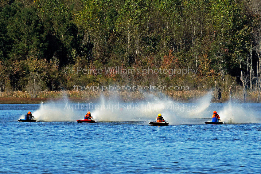 Racing out of turn one.   (outboard hydroplane)