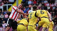 Lincoln City's Matt Rhead vies for possession with Morecambe's Kevin Ellison, Patrick Brough and Dean Winnard<br /> <br /> Photographer Andrew Vaughan/CameraSport<br /> <br /> The EFL Sky Bet League Two - Lincoln City v Morecambe - Saturday August 12th 2017 - Sincil Bank - Lincoln<br /> <br /> World Copyright &copy; 2017 CameraSport. All rights reserved. 43 Linden Ave. Countesthorpe. Leicester. England. LE8 5PG - Tel: +44 (0) 116 277 4147 - admin@camerasport.com - www.camerasport.com