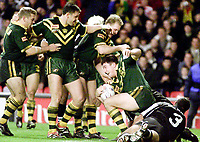 Picture by Shaun Flannery\SWpix.com - 25/11/00 - Rugby League World Cup Final 2000 - Australia v New Zealand, Old Trafford, Manchester, England - Australia try hero Nathan Hindmarsh is lifted by team mates after scoring his second half try.