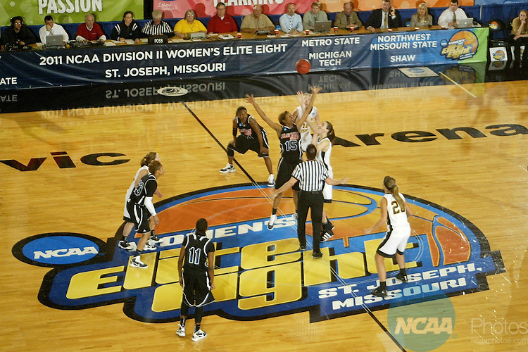 25 MAR 2011: Center Shacamra Jackson (15) of Clayton State and center Lisa Staehlin (14) of Michigan Tech jump the opening tip of the Division II Women's Basketball Championship held at the St. Joseph Civic Center in St. Joseph, MO. Clayton State defeated Michigan Tech 69-50 to win the national title game.  Matthew Hicks/NCAA Photos.