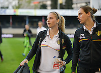 20140410 - LEUVEN , BELGIUM : Belgian Jana Coryn (left) pictured with Belgian Sabrina Broos (right) during the female soccer match between Belgium and Norway, on the seventh matchday in group 5 of the UEFA qualifying round to the FIFA Women World Cup in Canada 2015 at Stadion Den Dreef , Leuven . Thursday 10th April 2014 . PHOTO DAVID CATRY