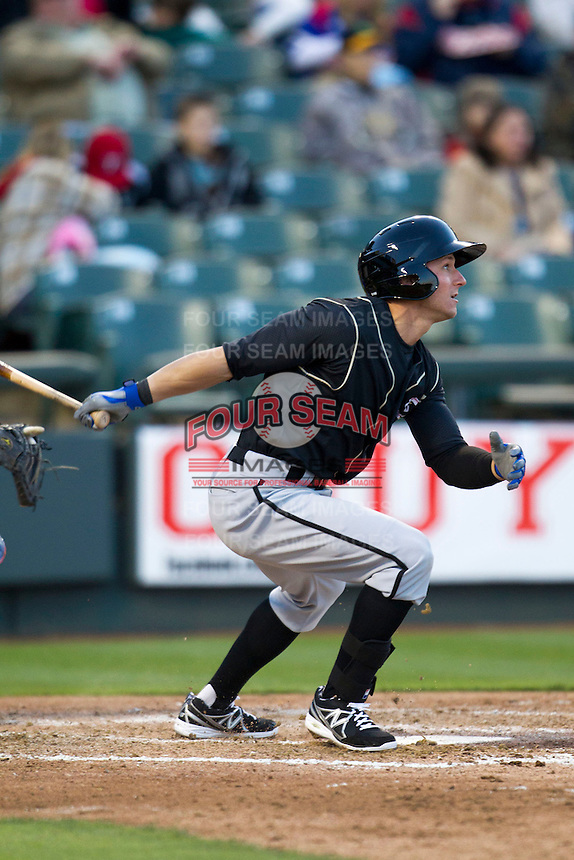 Omaha Storm Chasers outfielder David Lough #7 follows through on his swing against the Round Rock Express in the Pacific Coast League baseball game on April 4, 2013 at the Dell Diamond in Round Rock, Texas. Round Rock defeated Omaha in their season opener 3-1. (Andrew Woolley/Four Seam Images).