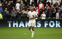 Pictured: Andre Ayew of Swansea thanks home supporters after the end of the game Sunday 30 August 2015<br /> Re: Premier League, Swansea v Manchester United at the Liberty Stadium, Swansea, UK