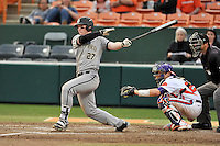 First baseman Brett Hash (27) of the Wofford College Terriers bats in a game against the Clemson University Tigers on Tuesday, March 1, 2016, at Doug Kingsmore Stadium in Clemson, South Carolina. The Clemson catcher is Chris Okey. Clemson won, 7-0. (Tom Priddy/Four Seam Images)
