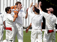Joel Gregory (2nd L) is mobbed by team mates after dismissing a Highgate player during the Middlesex County League Division Two game between Hornsey and Highgate at Tivoli Road, Crouch End on Saturday Aug 13, 2011