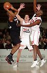 Basketball, BBL 2003/2004 , 1.Bundesliga Herren, Wuerzburg (Germany) X-Rays TSK Wuerzburg - GHP Bamberg (62:84) links Derrick Taylor (Bamberg) im Wurf, rechts Butch Tshomba (Wuerzburg) hinten Nils Mittmann (Wuerzburg)