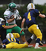 Darrin Simons #2 Farmingdale fights his way into the end zone as he returns an interception for a touchdown during the second quarter of a Nassau County Conference I varsity football game against host Massapequa High School on Saturday, Oct. 8, 2016. Farmingdale won by a score of 45-42.