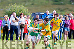 I'm Getting away<br /> ----------------------<br /> Maurice O'Connell, Team Cloghane, gets away from his marker Eoin Garvey, Team Castlegregory, during the Patrick Rohan Cup game near Brandon, which was last played between the parishes 70yrs ago, watched by a large crowd of supporters.