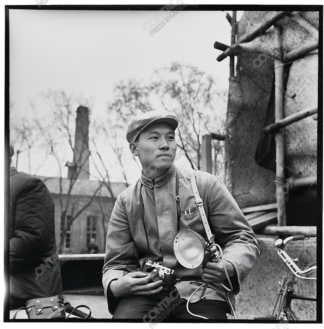 Li holding his Russian-made Kiev 35 mm camera and a German 6 x 6 Rolleiflex in Ashihe commune, Acheng county (photograph by Liu Guoqi). 12 May 1965