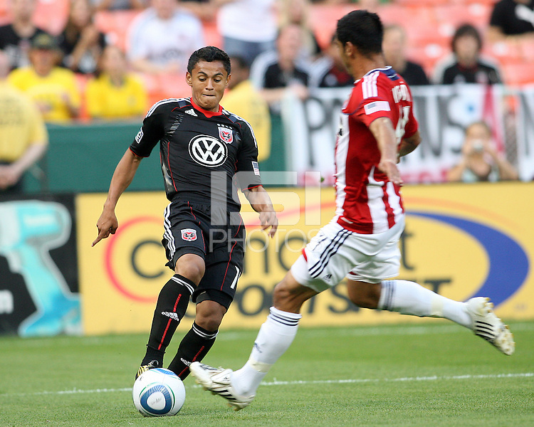 Andy Najar #14 of D.C. United pokes the ball past Michael Umana #4 of Chivas USA during an MLS match at RFK Stadium, on May 29 2010 in Washington DC. United won 3-2.