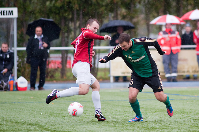 ALSBACH, GERMANY - OCTOBER 14: Verbandsliga match between FC Alsbach (green) and TS Ober-Roden (red) at FC Alsbach sports ground on October 14, 2012 in Alsbach, Germany. (Photo by Dirk Markgraf)